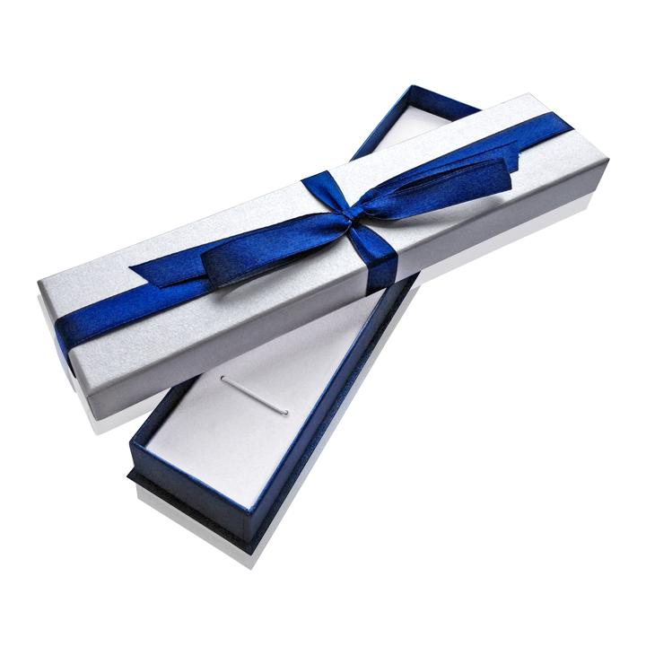 Подарункова коробка з синім бантом