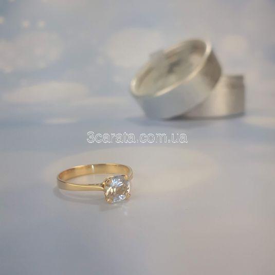 Золота каблучка для заручин з великим аквамарином «Еліс»