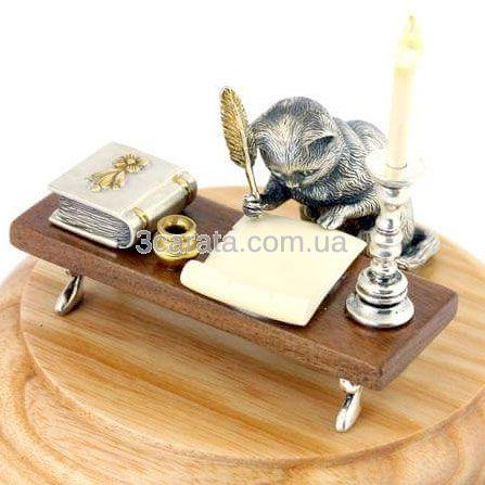 Срібна статуетка «Кіт за столом»