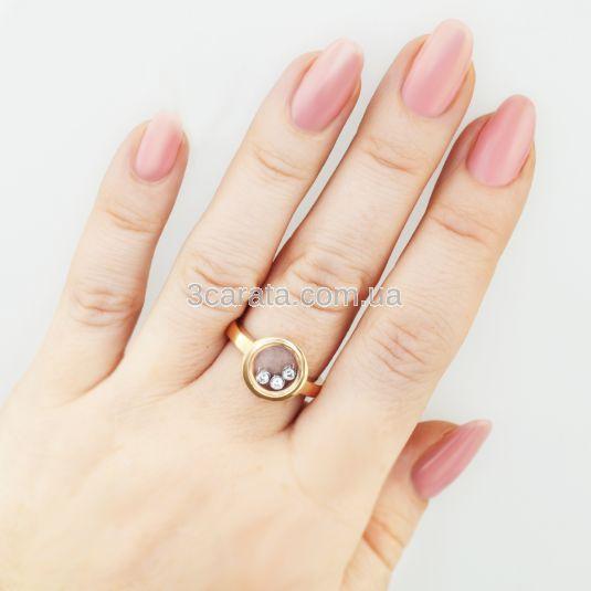 Золота каблучка з рухомим камінням «Плаваючі діаманти»
