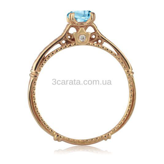 Золота заручальна каблучка з великим топазом «Закохана»