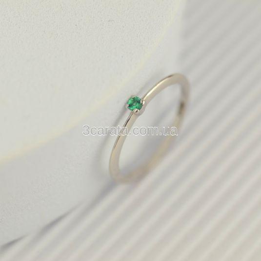 Тонкое золотое кольцо с одним изумрудом «Infini»