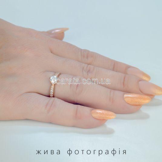 Золотое классическое кольцо с камнями Swarovski «История любви»