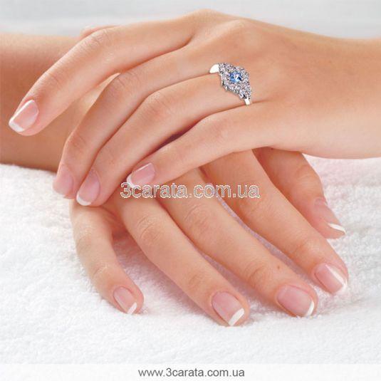 Золотое кольцо с топазом Swiss «Зимняя фантазия»
