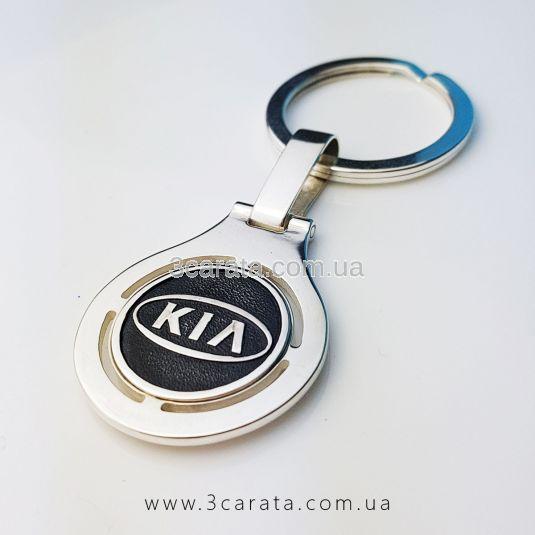 Брелок из серебра для ключей машины «КИА»