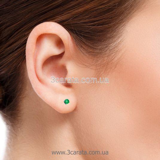 Одна золотая серьга гвоздик в ухо с изумрудом «One»