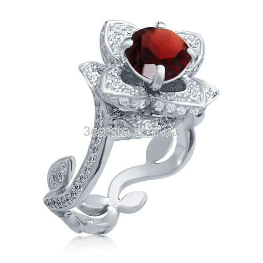 Золотое кольцо «Lotus» с красным гранатом