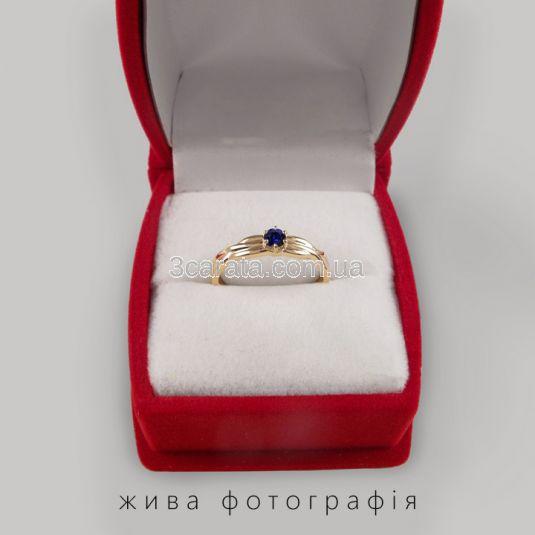 Золотое переплетенное кольцо с сапфиром «Долина грез»