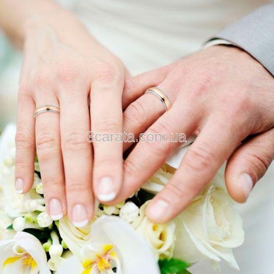 Золотые парные обручальные кольца без камней «Opera»