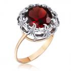 Красивое золотое кольцо с камнем гранатом