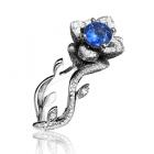 Золотое эксклюзивное кольцо «Lotus» с голубым топазом
