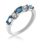 Золотое кольцо голубой топаз