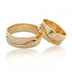 Золота обручка з цирконієм «На хвилях кохання»