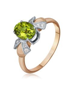 Роскошный зеленый камень хризолит в кольце из белого и красного золота 585 пробы