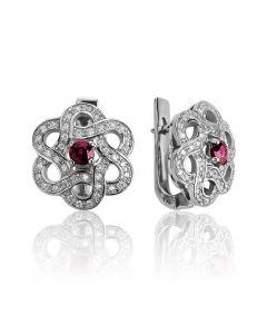 Золоті сережки з рубінами і Сваровські «Сніжна квітка»