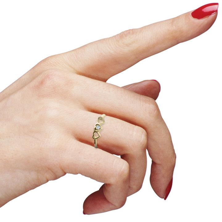 Золоте заручальне колечко з цирконом «Три сердечка»