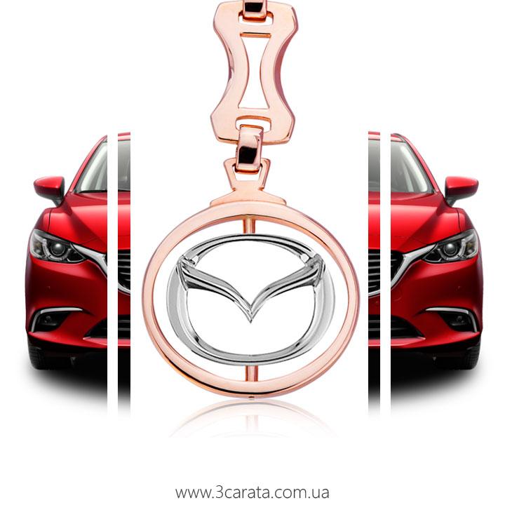 Золотой брелок 'Mazda'